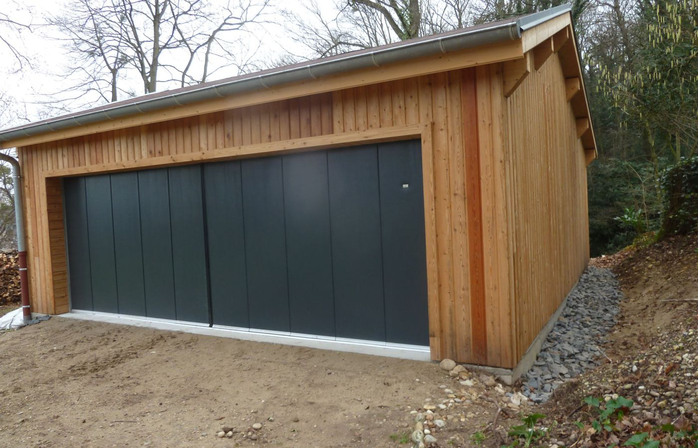 Garage en ossature bois rh ne toitures for Garage des communes acheres